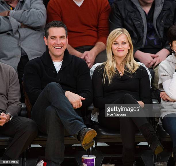 Reese Witherspoon and her husband Jim Toth attend a basketball game between the Toronto Raptors and Los Angeles Lakers at Staples Center on March 8,...