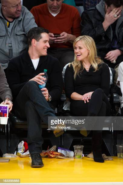 Reese Witherspoon and her husband Jim Toth attends a basketball game between the Toronto Raptors and Los Angeles Lakers at Staples Center on March 8,...
