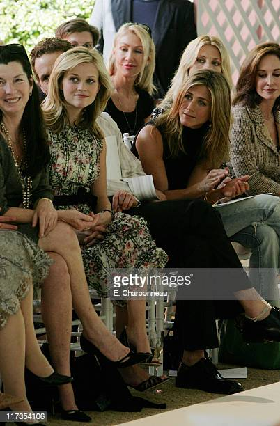 Reese Witherspoon and Jennifer Aniston during Veuve Clicquot Champagne at Couture Cares A benefit for breast cancer at Home of Colleen and Bradley...