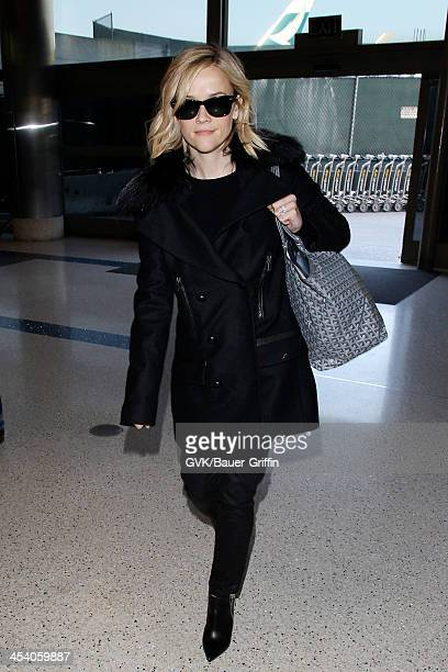 Reese Witherspoon and Jim Toth are seen arriving at LAX airport on December 06 2013 in Los Angeles California