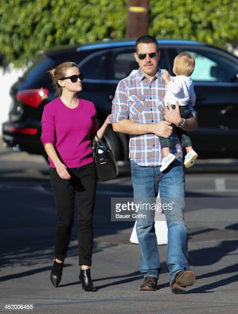 Reese Witherspoon and Jim Toth with son, Tennessee are seen on November 25, 2013 in Los Angeles, California.