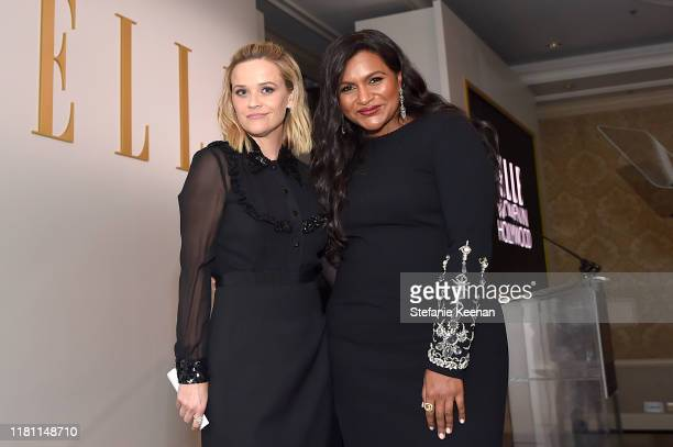 Reese Witherspoon and Mindy Kaling pose onstage during ELLE's 26th Annual Women In Hollywood Celebration Presented By Ralph Lauren And Lexus at The...