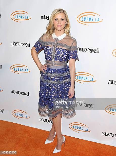 Reese Witherspoon arrives at the 12th Annual Lupus LA Hollywood Bag Ladies Luncheon at The Beverly Hilton Hotel on November 21 2014 in Beverly Hills...