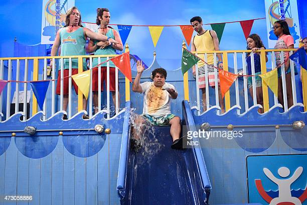 """Reese Witherspoon"""" Episode 1682 -- Pictured: Beck Bennett, Kyle Mooney and Bobby Moynihan during """"Waterslide"""" skit on May 9, 2015 --"""