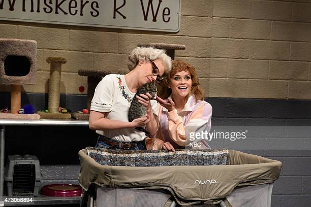 """Reese Witherspoon"""" Episode 1682 -- Pictured: Kate McKinnon as Barbara DeDrew and Reese Witherspoon as Purr-sula during """"Whiskers R We"""" skit on May 9,..."""