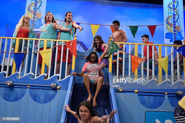 """Reese Witherspoon"""" Episode 1682 -- Pictured: Reese Witherspoon, Beck Bennett and Kyle Mooney during """"Waterslide"""" skit on May 9, 2015 --"""