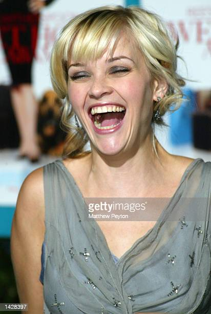 Reese Witherspoon laughs at the world premiere of Touchstone Pictures' 'Sweet Home Alabama' at the Chelsea West Cinema September 23 2002 in New York...