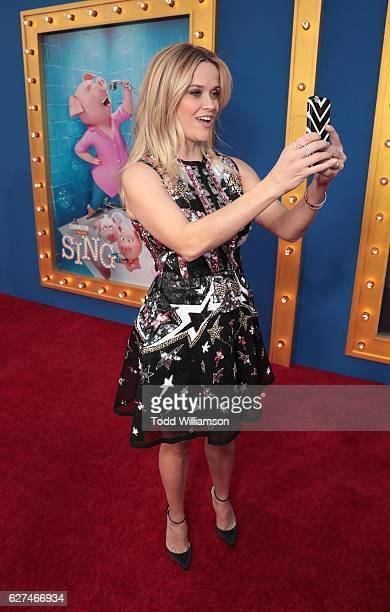 Reese Witherspoon takes a selfie at the premiere Of Universal Pictures' 'Sing' on December 3 2016 in Los Angeles California