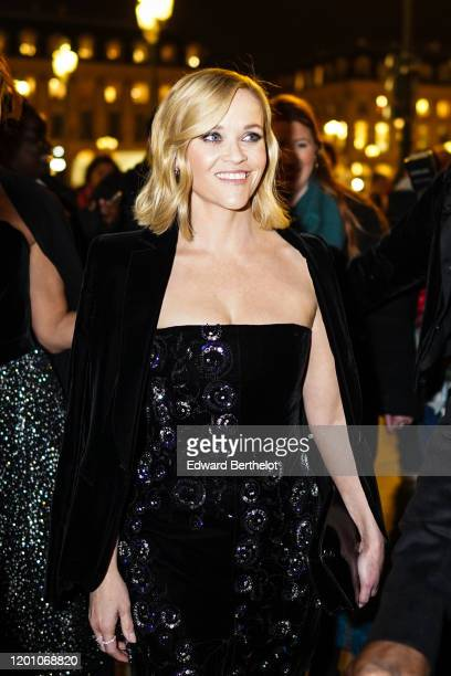 Reese Witherspoon wears an offshoulder dress and a black velvet jacket outside Armani during Paris Fashion Week Haute Couture Spring/Summer 2020 on...
