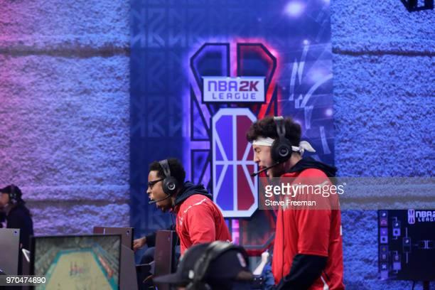 ReeseDaGod23 and Jin of Wizards District Gaming react against 76ers Gaming Club during the NBA 2K League Mid Season Tournament on June 9 2018 at the...