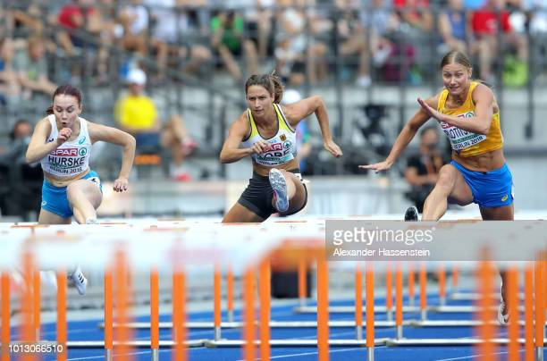 Reeta Hurske of Finland Ricarda Lobe of Germany and Hanna Plotitsyna of Ukraine competes in the Women's 100 metres hurdles heats during day two of...