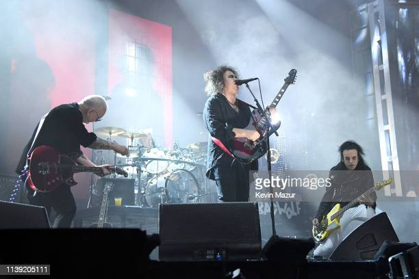 Reeves Gabrels Robert Smith and Simon Gallup of The Cure perform at the 2019 Rock Roll Hall Of Fame Induction Ceremony Show at Barclays Center on...