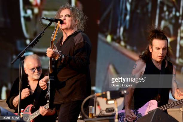 Reeves Gabrels Robert Smith and Simon Gallup of The Cure perform on stage as Barclaycard present British Summer Time Hyde Park at Hyde Park on July 7...