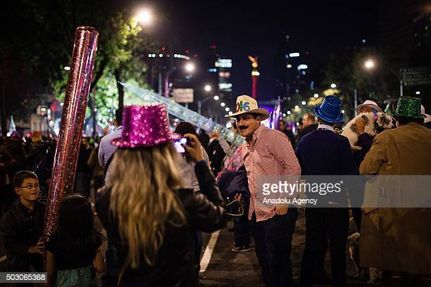 Reevlers are seen in the Angel de la Independencia in the New Year's eve celebaration in Mexico City Mexico on December 31 2015
