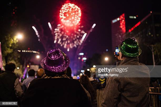 Reevlers watches the fireworks show in the Angel de la Independencia in the New Year's eve celebaration in Mexico City Mexico on December 31 2015