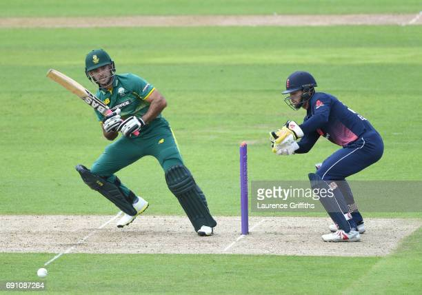 Reeza Hendricks of South Africa A hits out in front of Ben Foakes of England Lions during the One Day International match between England Lions and...