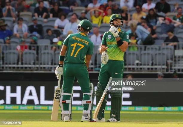 Reeza Hendricks of South Africa and Aiden Markram of South Africa watch the big screen during a drs challenge during game one of the One Day...