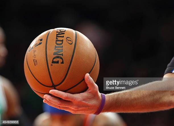 A ref hands off the ball during the game between the New York Knicks and the Boston Celtics at Madison Square Garden on December 8 2013 in New York...
