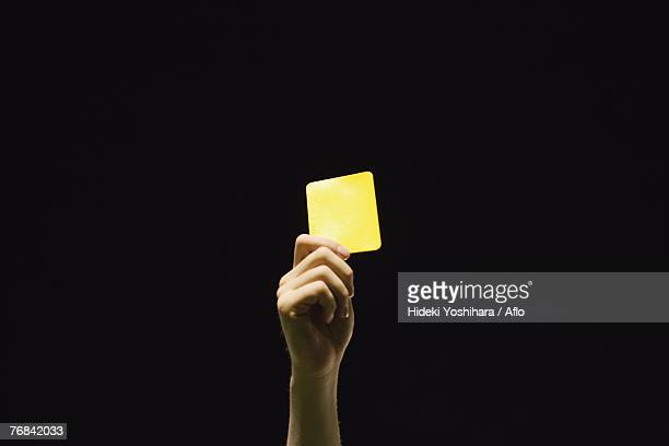 ref showing yellow card - yellow card stock pictures, royalty-free photos & images