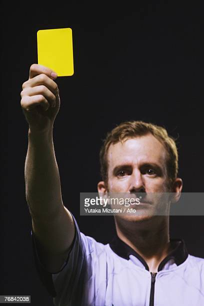 Ref Showing Yellow Card
