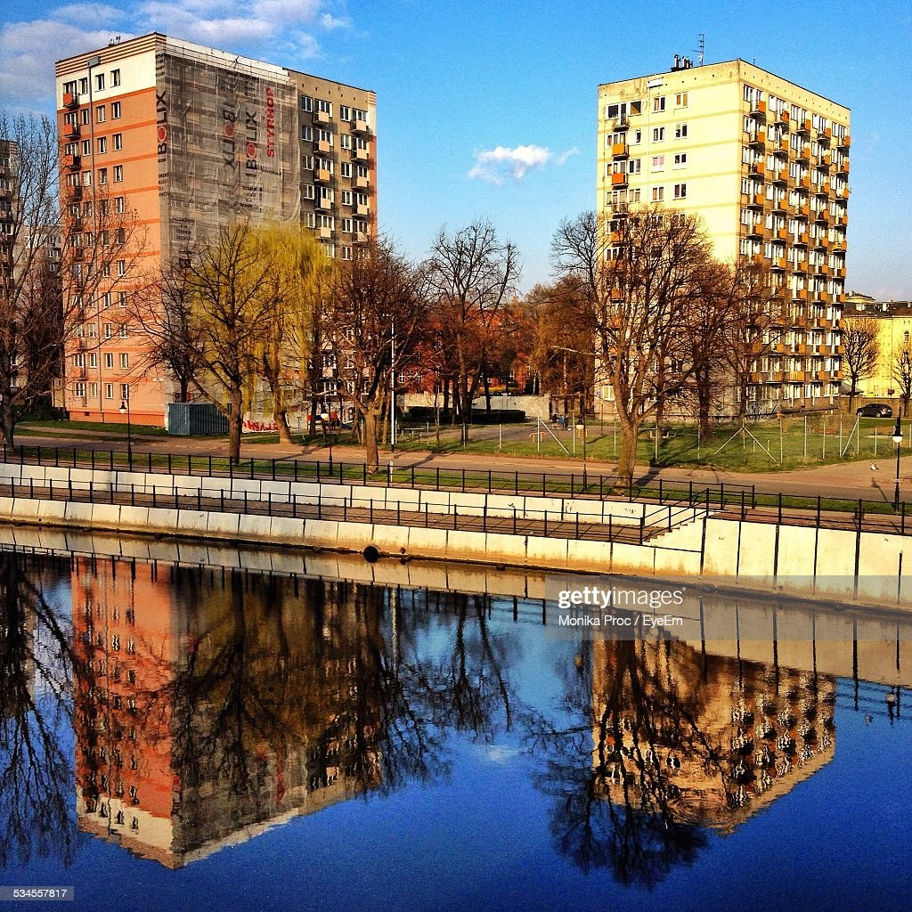 Refection Of Buildings In Calm River : Stock Photo