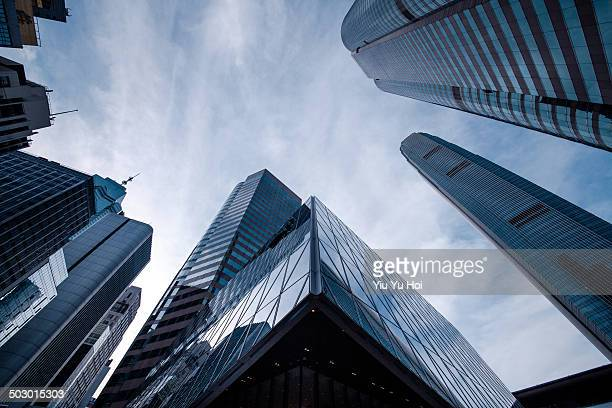 refection of buildings on a skyscraper facade - 真下からの眺め ストックフォトと画像