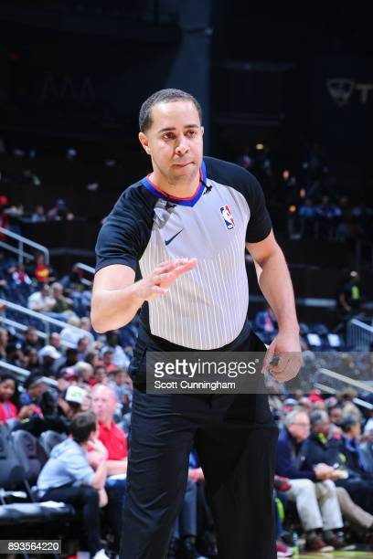 Refeee Jonathan Sterling makes a call during the Detroit Pistons game against the Atlanta Hawks on December 14 2017 at Philips Arena in Atlanta...