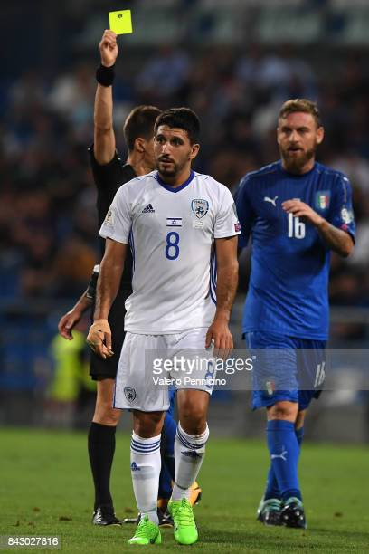 Refeer Benoit Bastien show yellow card to Almog Cohen of Israel during the FIFA 2018 World Cup Qualifier between Italy and Israel at Mapei Stadium...
