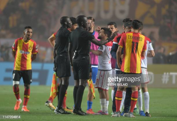 Refere Gambian Bakary Papa Gassama speeks with Wyded team players after the Video assistant referee system did not work and the match was interromped...