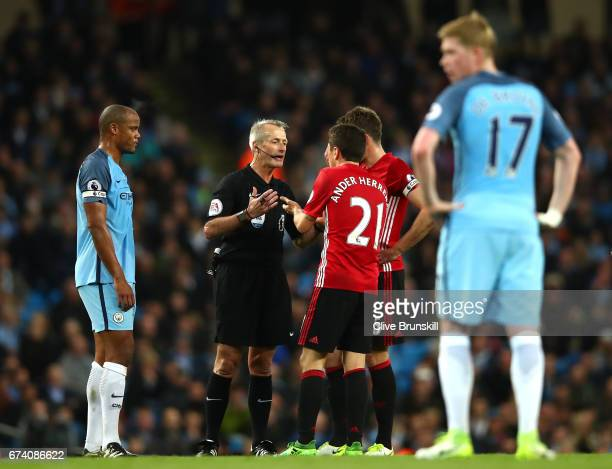 Refere Martin Atkinson speaks with Ander Herrera of Manchester United during the Premier League match between Manchester City and Manchester United...