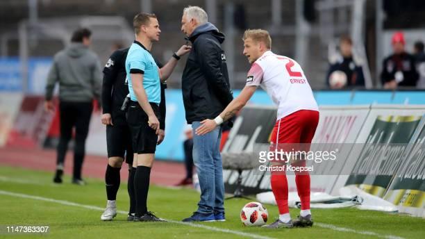 Refere Robert Kampka talks to head coach Christian Neidhardt of Meppen during the 3. Liga match between SC Fortuna Koeln and SV Meppen at Suedstadion...