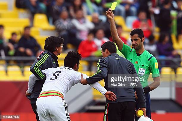 Referee Abdulrahman al Jassim shows the yellow card to injured Eduardo Aguirre of Mexico during the FIFA U-17 World Cup Chile 2015 Third Place...