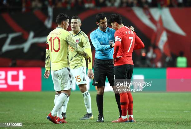 referee Abdulrahman Al Jassim talks with James Rodriguez of Colombia and Son Heungmin of South Korea during the International Friendly match between...