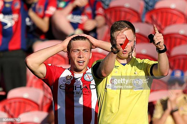 Referee Adam Fielding issues a red card to Jacob Melling of Melbourne City during the round 18 ALeague match between the Newcastle Jets and Melbourne...