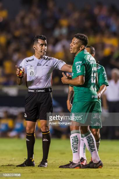 Referee Adonai Escobedo argues with Alexander Mejia of Leon during the 1st round match between Tigres UANL and Leon as part of the Torneo Apertura...