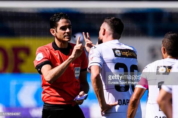 Referee Adrien Jaccottet talks to Fabio Daprelà of Lugano during the Swiss Swiss Raiffeisen Super League match between FC Luzern and FC Lugano at the...