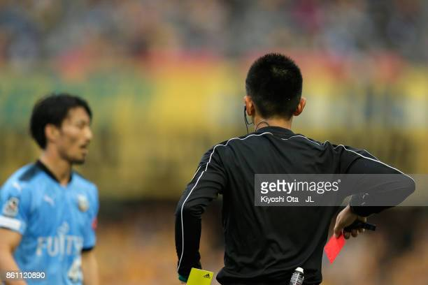 Referee Akihiko Ikeuchi shows second yellow card and takes a red card to Akihiro Ienaga of Kawasaki Frontale during the JLeague J1 match between...