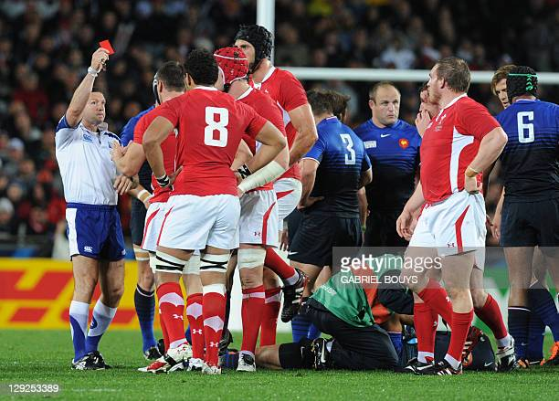 Referee Alain Rolland of Ireland gives a red card to Wales' flanker Sam Warburton during the 2011 Rugby World Cup semi-fianl match Wales vs France at...