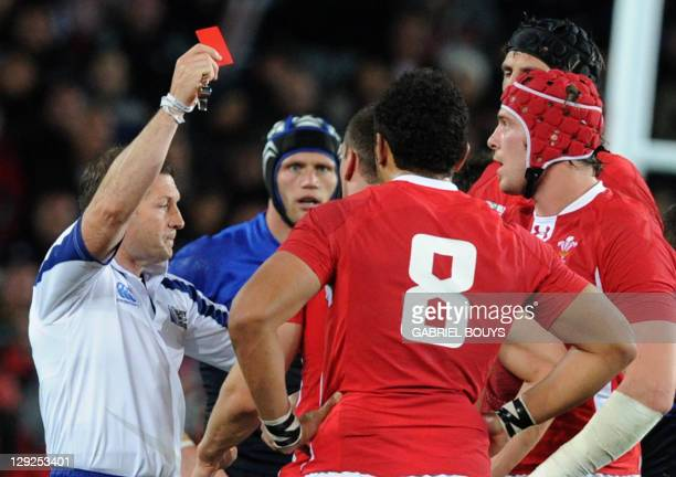 Referee Alain Rolland of Ireland gives a red card to Wales' flanker Sam Warburton during the 2011 Rugby World Cup semifianl match Wales vs France at...