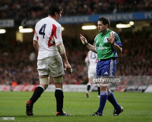 Referee Alain Rolland of Ireland lectures Martin Corry of England after he struck Wale's Alix Popham during the RBS Six Nations Championship match...