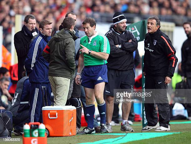 Referee Alain Rolland repremands Harlequins team manager Graeme Bowerbank for catching the ball whilst the ball was in touch looking on is Toulouse...