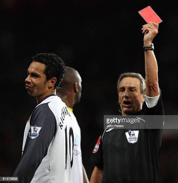 Referee Alan Wiley sends off Kieran Richardson of Sunderland during the FA Barclays Premier League match between Manchester United and Sunderland at...