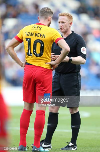 Referee Alan Young imakes a point to Kevin van Veen of Northampton Town during the Sky Bet League Two match between Colchester United and Northampton...