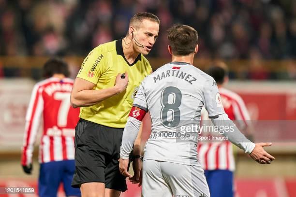 Referee Alberola Rojas talks with Antonio Martinez of Cultural Leonesa during the Copa del Rey round of 32 match between Cultural Leonesa and...