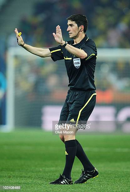 Referee Alberto Undiano gestures during the 2010 FIFA World Cup South Africa Group G match between North Korea and Ivory Coast at the Mbombela...