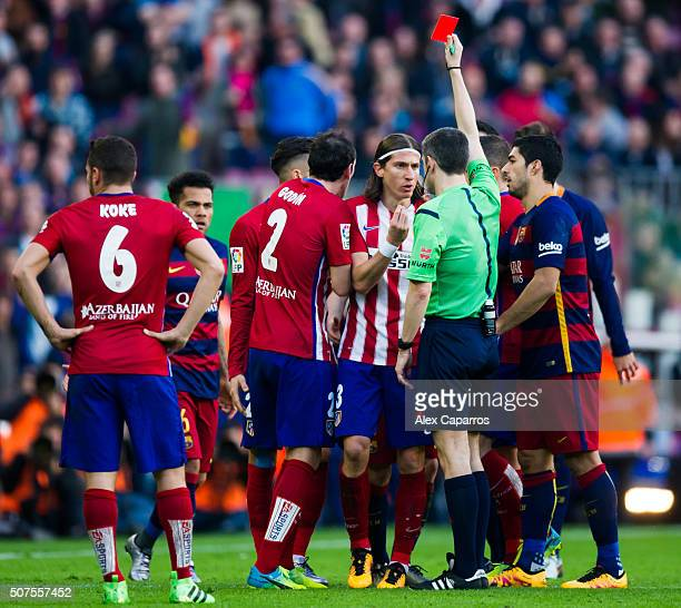 Referee Alberto Undiano Mallenco shows a red card to Filipe Luis after fouling Lionel Messi during the La Liga match between FC Barcelona and Club...