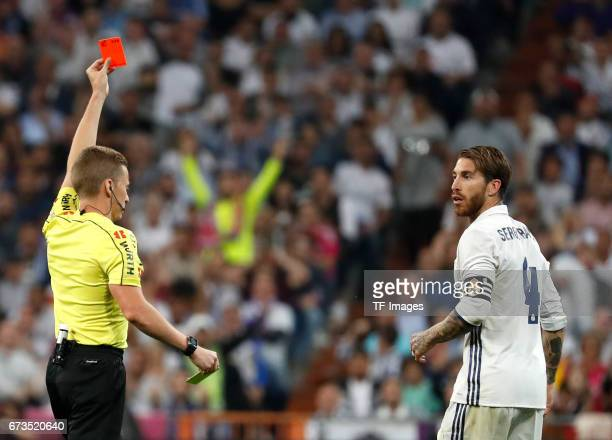 Referee Alejandro Hernandez Hernandez shows Sergio Ramos of Real Madrid the red card during the La Liga match between Real Madrid CF and FC Barcelona...