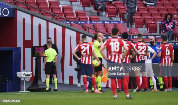 Referee, Alejandro Jose Hernandez Hernandezas checks the VAR monitor for a potential handball on Nacho of Real Madrid during the La Liga Santander...