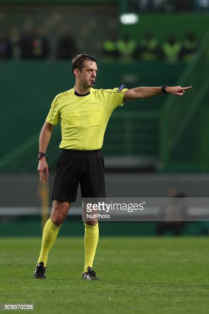 Referee Aleksei Kulbakov of Belarus gestures during the UEFA Europa League round of 16 1st leg football match Sporting CP vs Viktoria Plzen at the...