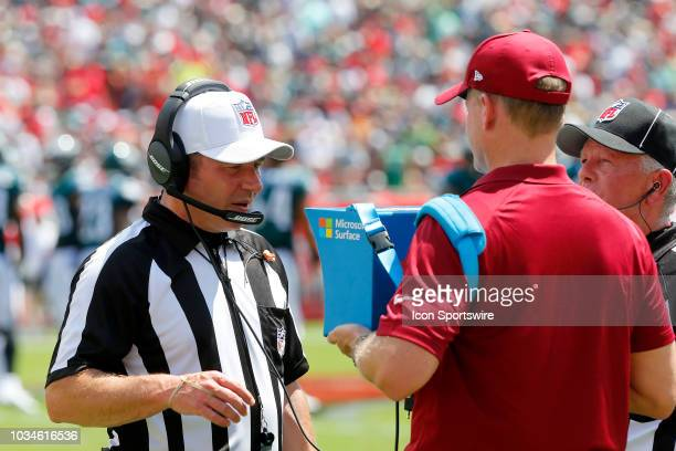 Referee Alex Kemp watches the instant replay on the Microsoft Surface during the regular season game between the Jacksonville Jaguars and the Tampa...